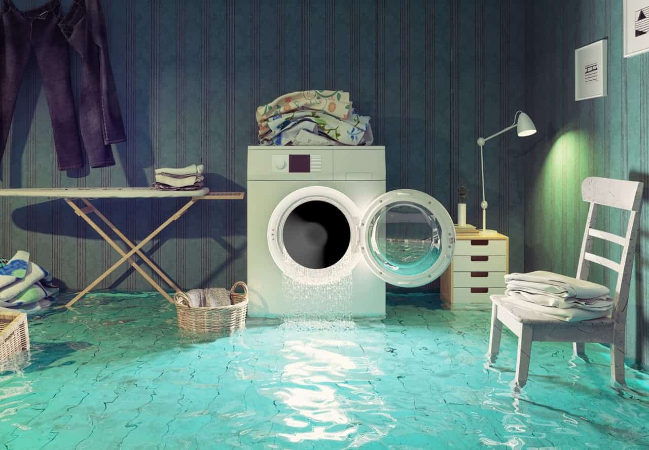 a laundry room with flood damages and water restoration